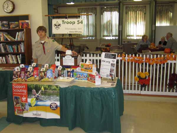Troop 54 Scout selling popcorn at the 2012 Harvest Fair