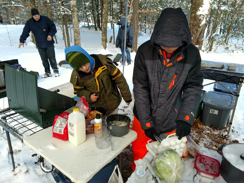 Troop 54 Boy Scouts prepare breakfast at Horace Moses Scout Reservation.